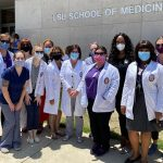Group of nurses standing outside LSU School of Medicine