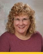 Paula Kensler, DNP, MBA, RN, Program Director for the Clinical Nurse Leader Master's and Executive Nurse Leader Doctor of Nursing Practice (DNP) programs and Instructor of Clinical Nursing, is pictured in a headshot.